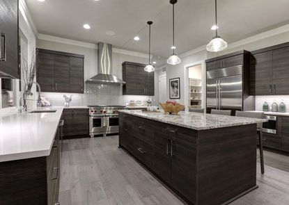 #4. Upscale major kitchen remodel | Average cost: $149,079 - Average resale value: $80,284 - Percentage of cost recouped: 53.9% | A high-end, major kitchen remodel can be a truly worthy investment for homeowners planning to enjoy the fruits of their labor, but these projects on the whole don't add much by way of financial return. Upscale kitchen improvements cost nearly $150,000 on average and run the risk of not matching a buyer's vision for the space. In such a situation, your investment is ultimately rendered moot. All the details of a kitchen only increase the likelihood of your aesthetic not matching a prospective buyer's. (Breadmaker/Shutterstock)