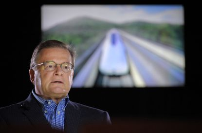 Baltimore, MD -- 06/06/2018 -- A monitor displays a video loop of a maglev train operating in Japan while Wayne Rogers, Chairman and CEO of The NorthEast Maglev speaks of his proposal to build a magnetic levitation train between Baltimore and Washington with the help of the Japanese government and Japanese private industry partners. (Karl Merton Ferron / Baltimore Sun Staff)
