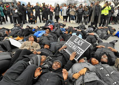 """More than 500 protesters marched from Empowerment Temple Church on Primrose Avenue north on Reisterstown Road to Reisterstown Road Plaza for """"Black Lives Matter Sunday."""""""