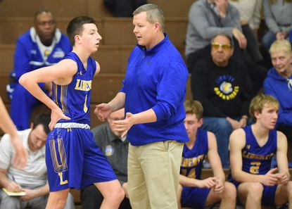 Liberty head coach Brian Tombs gives instructions to sophomore Shane Stewart along the bench during a boys basketball game at South Carroll High School on Tuesday, Feb. 5.
