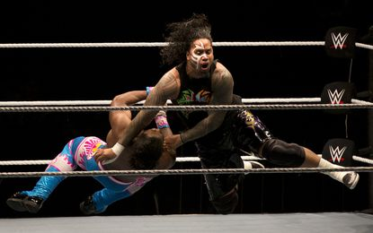 WWE wrestler Jimmy Usos, right, puts down Kofi Kingston during WWE Live India Tour, in New Delhi, Friday, Jan. 15, 2016.
