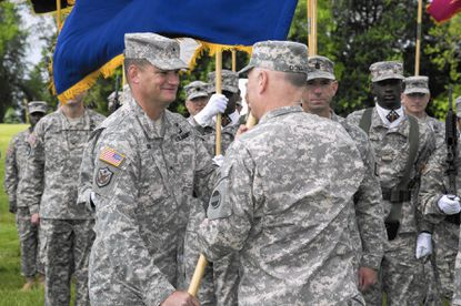 Brig. Gen. William E. King IV, left, receives the 20th CBRNE Command colors from U.S. Army Forces Command Deputy Commanding General Lt. Gen. Patrick J. Donahue II during the change of command ceremony on Aberdeen Proving Ground May 20.
