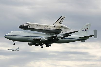 Space Shuttle Discovery is shown coming in for a landing at Dulles International Airport April 17.