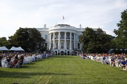 "Guests wait for President Donald Trump and first lady Melania Trump during a ""Salute to America"" event on the South Lawn of the White House July 4, 2020, in Washington."