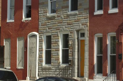 Several rowhouses in Sandtown-Winchester. Which of these is not like the other?
