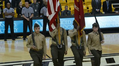 Members of the Franklin High School JRTOC Marine Color Guard on the court at the Towson University vs. Hofstra basketball game on Jan. 11.