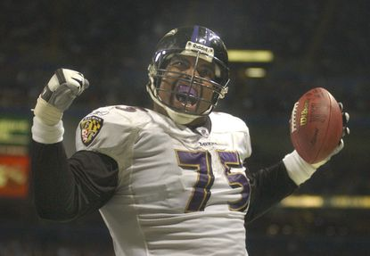Ravens tackle Jonathan Ogden reacts after scoring a touchdown against the Ravens in a 2003 game in St. Louis.