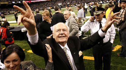 Tom Benson celebrates after the New Orleans Saints defeated the Dallas Cowboys during the 2009 season, when they ended up winning the Super Bowl.