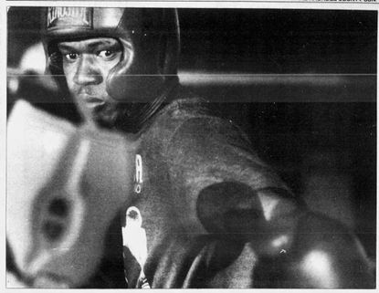 Cecil Sims prepares for his pro boxing debut in 1990.