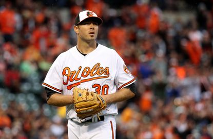 Orioles starting pitcher Chris Tillman walks off the mound after retiring the side against the Minnesota Twins in the second inning of their Opening Day game at Camden Yards on April 4, 2016 in Baltimore.