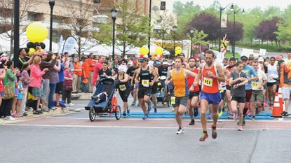 Participants run through Maple Lawn during last year's annual Maryland Half Marathon and 5K for the University of Maryland's Marlene and Stewart Greenebaum Comprehensive Cancer Center.