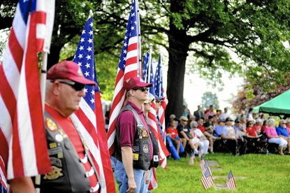 Members of the Patriot Guard Riders, as well as spectators, observe the Memorial Day celebration at the Dulaney Valley Memorial Gardens in Timonium on Monday.