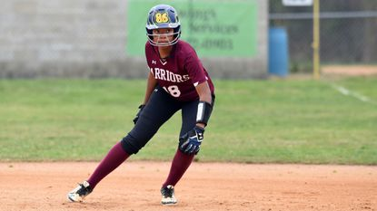 Havre de Grace's Natiah Turner takes her lead from first base, keeping a close eye on the batter during Monday afternoon's game against North East at Stancill Park in Havre de Grace. Turner had Havre de Grace's only hit.