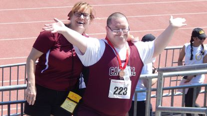Woody Higgs is shown with Special Olympics Carroll County Track and Field coach Kathy Zuback after Higgs won a gold medal at the 2018 Summer Games in Towson.