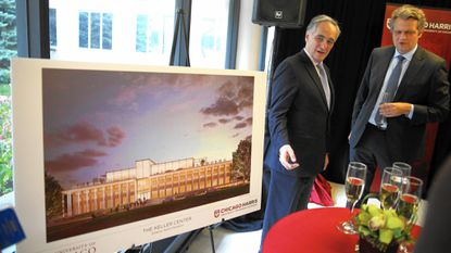 University of Chicago President Robert Zimmer, left, and Harris School Dean Daniel Diermeier talk Wednesday about plans for a new home for the public policy school, made possible by a large monetary gift from Dennis Keller. The new building, shown in drawing, will be called the Keller Center.