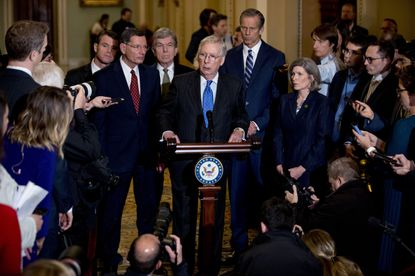 Senate Majority Leader Mitch McConnell, R-Ky., accompanied by, from left, Sen. Todd Young, R-Ind., Sen. John Barrasso, R-Wyo., Sen. Roy Blunt, R-Mo., Senate Majority Whip Sen. John Thune, R-S.D., and Sen. Joni Ernst, R-Iowa, speaks to reporters during a news conference on Capitol Hill.