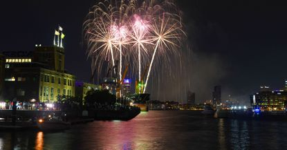 Fourth of July fireworks light up the inner harbor as seen from Tide Point.