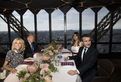 President Donald Trump, first lady Melania Trump, French President Emmanuel Macron his wife Brigitte Macron, are photographed as they sit for dinner at the Jules Verne Restaurant on the Eiffel Tower in Paris, Thursday, July 13, 2017.
