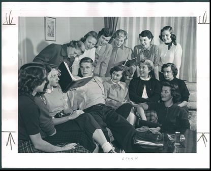 Jack Scarbath is surrounded by girls in Maryland's Delta Gamma sorority house in a 1952 photo. Lynn Brown, pictured just above him, has now been his wife for 62 years.