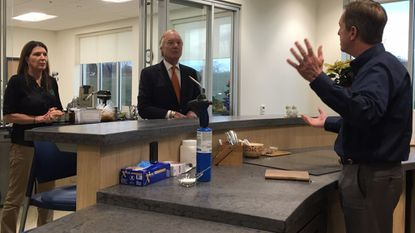 Maryland Comptroller Peter Franchot, center, speaks with Fuchs North America Director of Human Resources and Operations Lori Blake, left, and Vice President of Sales and Technical Services Ken Wuestenfeld during a tour of the company on Thursday in Hampstead.