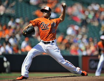 Wei-Yin Chen delivers in the first inning against the White Sox.