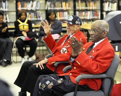 Lemuel Lewie, left, and Dr. Cyril Byron, right, are members of the Tuskegee Airmen. They visited Randallstown High School for a presentation to students..