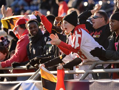 Graham Albers of Frederick cheers Maryland's first-quarter touchdown Friday against Marshall in the Military Bowl at Navy-Marine Corps Memorial Stadium in Annapolis.