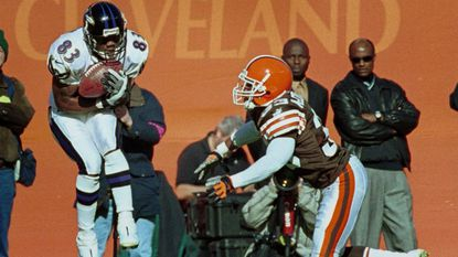 Ravens wide receiver Patrick Johnson catches a pass from Tony Banks in the first quarter behind Browns cornerback Daylon McCutcheon at Cleveland Browns Stadium on Sunday, Nov. 7, 1999.