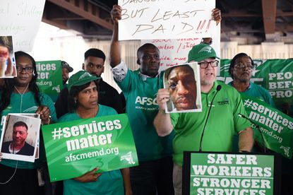 Patrick Moran, AFSCME Maryland Council 3 president, speaks at a rally in Baltimore earlier this year. He's hailing a judge's proposed decision that Gov. Larry Hogan's administration committed an unfair labor practice against the union during wage negotiations in 2018.