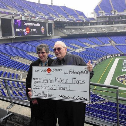 Vernon Miller Jr., 74, of Bel Air, who won 20 years of season tickets to Ravens games Friday, said he will be taking his wife, Pat, left, to the games with him. The club level tickets were the top prize in a special Maryland Lottery promotion.