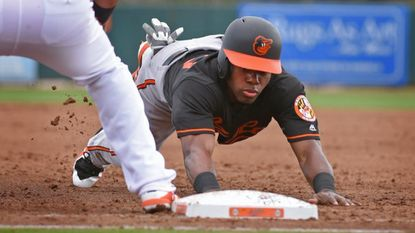 Cedric Mullins dives back to first base on a pickoff attempt in the Orioles' intrasquad game. Mullins, the Orioles' 13th-round draft pick in 2015, is trying to earn a big league roster spot after recovering from a hamstring injury last season.