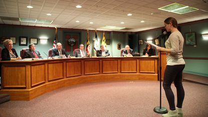 Hampstead resident Brittany Phillips addresses the Mayor and Town Council Tuesday, Nov. 13. Phillips implored that council employ EPA-sponsored environmental tests to assure it's safe to build homes on a 118-acre site dubbed Hampstead Overlook.