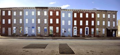 Vacant buildings stand in the 1800 block of East Chase St. The block is near Eager Park, a six-acre park that will run through the mixed-use development near the Johns Hopkins Medicine campus.