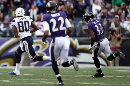 Wide receiver Malcom Floyd of the San Diego Chargers scores a third quarter touchdown past strong safety Will Hill #33 of the Baltimore Ravens and cornerback Jimmy Smith #22 of the Baltimore Ravens during a game at M&T Bank Stadium on November 1, 2015 in Baltimore, Maryland. It is one of four pass plays of at least 60 yards allowed by the Ravens over the first half of the season.