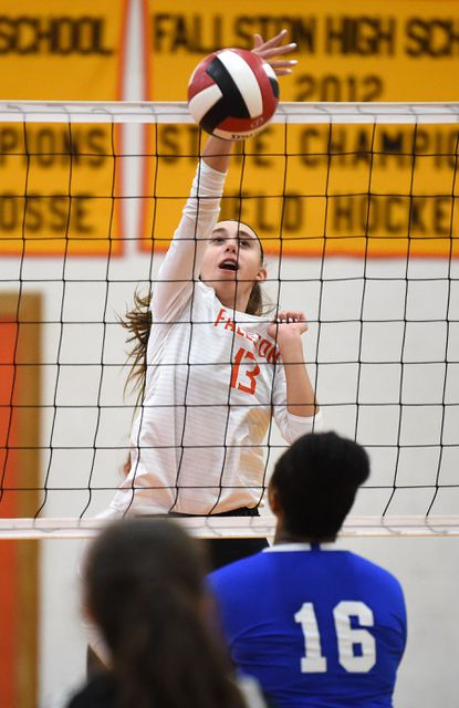 Fallston's Ellery Thompson gets up to tap the ball over the net to the North East side during Monday afternoon's girls 2A volleyball playoff match at Fallston High School.
