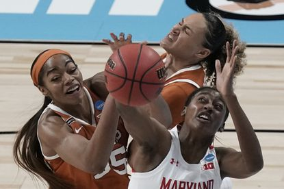 Maryland's Diamond Miller battles for a rebound with Texas's Celeste Taylor and Charli Collier during the first half of an NCAA college basketball game in the Sweet 16 round of the Women's NCAA tournament Sunday, March 28, 2021, at the Alamodome in San Antonio. (AP Photo/Morry Gash)