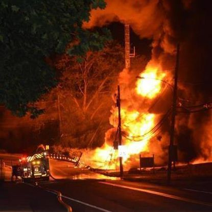 Flames shoot skyward after tanker truck carrying gasonline crashed and burned at the bottom of a steep hill going into Port Deposit Friday night. The driver was killed.