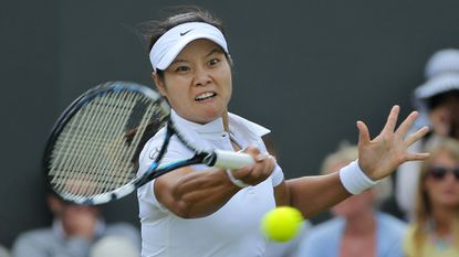 Li Na returns a shot during her second-round victory over Yvonne Meusburger at Wimbledon on Wednesday.