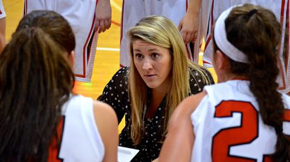 Katherine Bixby, women's basketball coach at Dickinson College in Carlisle, Pa., the last three years, was named Friday as the new coach at Johns Hopkins.