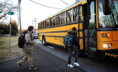 High school students board their bus on Baltimore Annapolis Blvd. in Anne Arundel County at 6:50 a.m. Some parents say school starts too early for teen students, and Anne Arundel is one of several schools systems studying start times.
