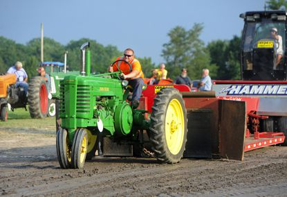 Todd Piper tightens the chain and gets underway during one of his turns on the track in the antique tractor pull event at the Harford County Farm Fair in 2017.