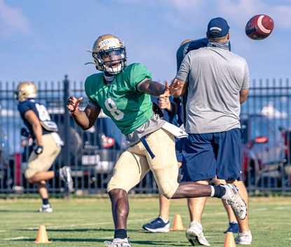 Navy starting quarterback Dalen Morris delivers a pitch to a slotback during training camp this month. Morris never wavered in the belief he could one day lead Navy's patented triple-option offense.