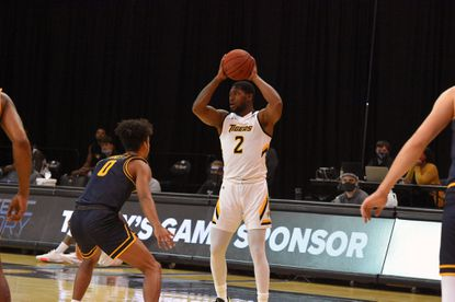 Towson's Zane Martin studies the Coppin State defense during the Tigers' victory on Saturday.x