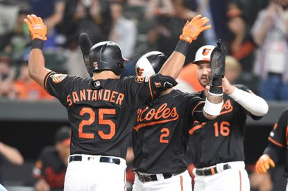 Anthony Santander of the Orioles celebrates a three-run home run in the first inning with Jonathan Villar #2 and Trey Mancini #16 during a win over the Seattle Mariners at Oriole Park at Camden Yards on Friday night.