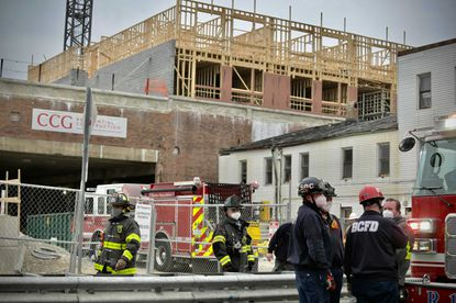 Emergency personnel gather at the scene of a partially collapsed scaffolding and construction site on Aliceanna Street in Fells Point.