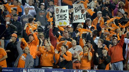 Fans cheer before Game 1 of the American League Championship Series at Camden Yards.
