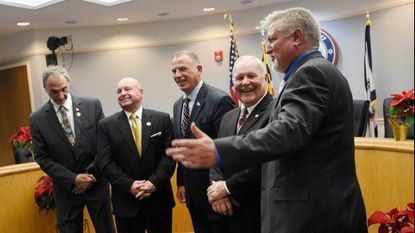 Carroll County Commissioners, from left, Dennis Frazier Stephen Wantz, Ed Rothstein, Richard Weaver and Eric Bouchat stand for pictures after they were sworn in by Carroll County Clerk of Court Heather DeWees during a ceremony in Westminster Tuesday, Dec. 4, 2018.