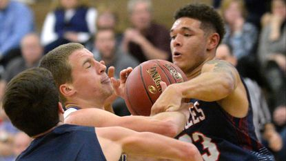 Francis Scott Key's Amir Cole, right, scored 24 points to lead the Eagles past Manchester Valley Thursday night.