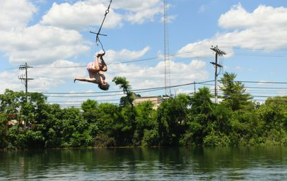 Luke Ruel of Dunkirk, Md., performs a flip as he releases from the rope swing, into the quarry at Beaver Dam Swimming Club on Wednesday, June 23, 2021.