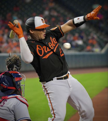 Baltimore Orioles batter Pedro Severino reacts just in time above Cleveland Indians catcher Austin Hedges, on an inside heater by Cleveland reliever Nick Sandlin at Oriole Park at Camden Yards Fri., June 4, 2021. Baltimore prevailed, 3-1. (Karl Merton Ferron/Baltimore Sun Staff)